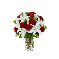 luxury-long-stem-dozen-has-red-rose-white-stargazer-lilies-in-a-vase